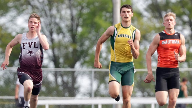 Fox Valley Lutheran High School's Eric Wenzel, left, Freedom High School's Caden Hofacker, center and Wautoma High School's Cade Peterson compete in the 200m dash during the WIAA Division 2 track and field sectional on Thursday, May 24, 2018 in Freedom, Wis.Wm. Glasheen/USA TODAY NETWORK-Wisconsin