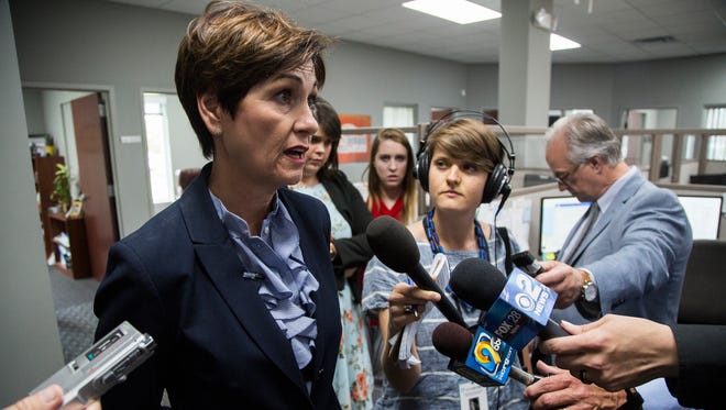 Iowa Governor Kim Reynolds holds a news conference after signing the largest state tax cut in Iowa's history on Wednesday, May 30, 2018 at MobileDemand in Hiawatha.