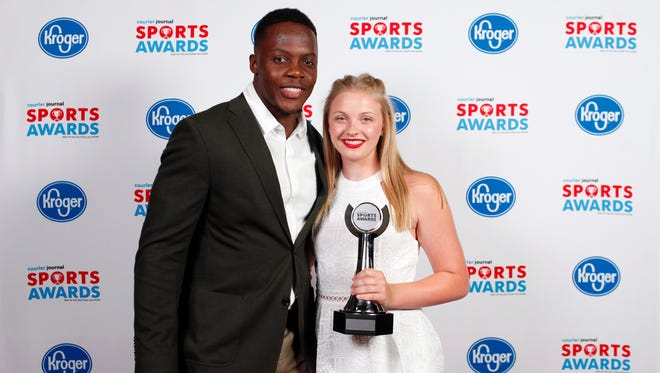 Teddy Bridgewater poses with Summer Allen, winner of the I AM SPORT award, during the 2018 Courier Journal Sports Awards held at The Louisville Palace in downtown Louisville. June 7, 2018