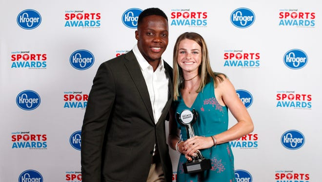 Teddy Bridgewater poses with Carrie Beckman, winner of the Girls Tennis Player of the Year award, during the 2018 Courier Journal Sports Awards held at The Louisville Palace in downtown Louisville. June 7, 2018