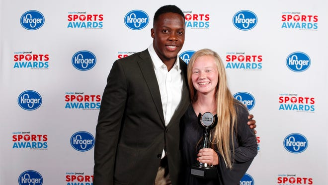 Teddy Bridgewater poses with Katie Gerber, winner of the Girls Lacrosse Player of the Year award, during the 2018 Courier Journal Sports Awards held at The Louisville Palace in downtown Louisville. June 7, 2018