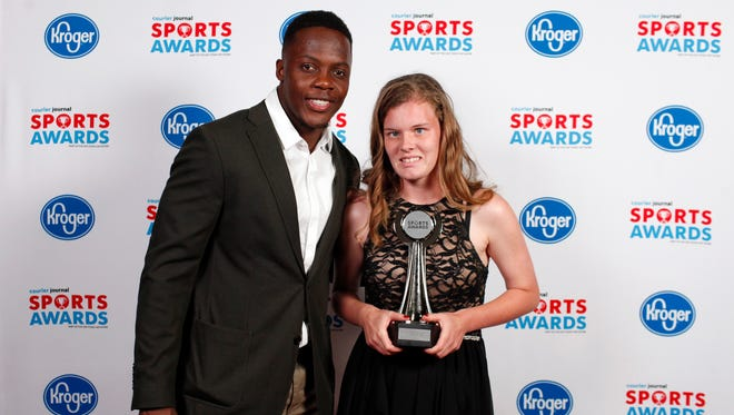 Teddy Bridgewater poses with Caitlin Roy, winner of the Girls Special Olympics Athlete of the Year award, during the 2018 Courier Journal Sports Awards held at The Louisville Palace in downtown Louisville. June 7, 2018