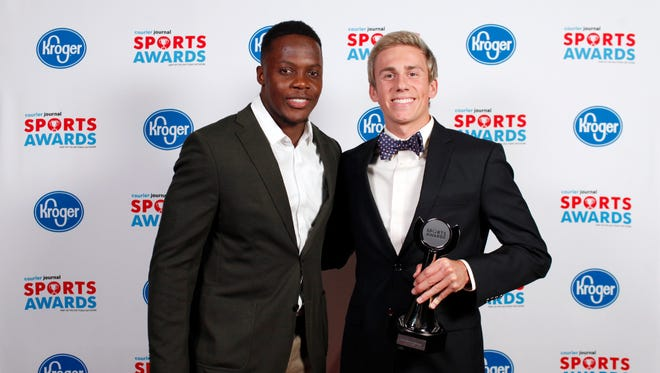 Teddy Bridgewater poses with Will Travestad, winner of the Boys Swimmer of the Year Award, during the 2018 Courier Journal Sports Awards held at The Louisville Palace in downtown Louisville. June 7, 2018
