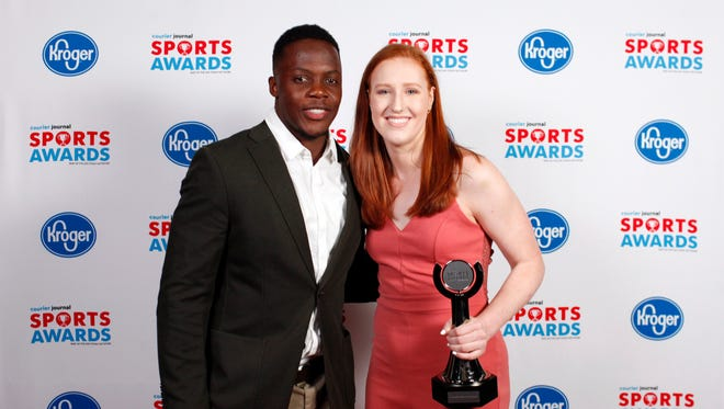Teddy Bridgewater poses with Lilly Hatton, winner of the Academic Achievement Award, during the 2018 Courier Journal Sports Awards held at The Louisville Palace in downtown Louisville. June 7, 2018