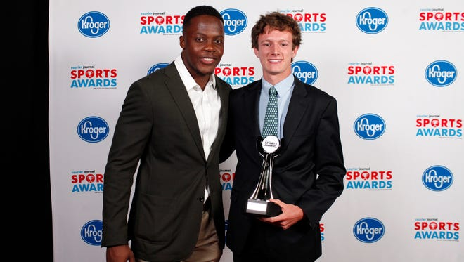 Teddy Bridgewater poses with Trinity's Trevor Warren, winner of the Boys Track and Field Athlete of the Year Award, during the 2018 Courier Journal Sports Awards held at The Louisville Palace in downtown Louisville. June 7, 2018