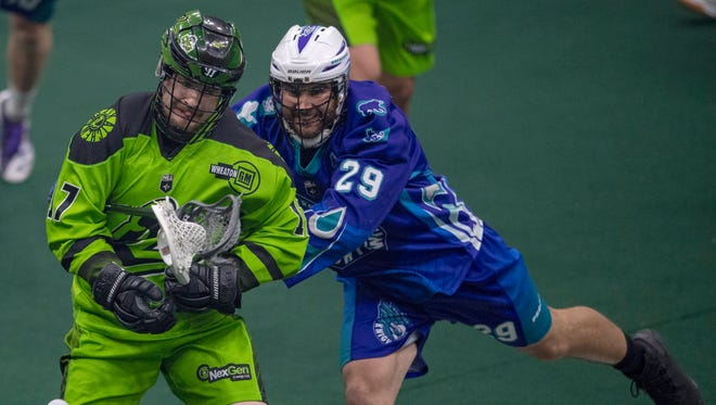 Saskatchewan Rush forward Robert Church, left, and Rochester Knighthawks defense Ian Llord battle for the ball during the first quarter of Game 3 of the the National Lacrosse League finals in Saskatoon, Saskatchewan, Saturday, June 9, 2018.