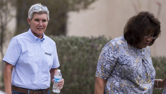 Arizona State Parks & Trails Director Sue Black and an Arizona Department of Administration official leave the home of Sue Hartin on June 15, 2018, in El Mirage. Hartin, a State Parks employee who was fired while battling cancer, will be rehired.