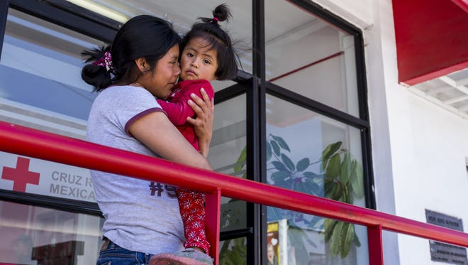 Nancy Gonzalez, 23, of Guatemala, holds her daughter, Angie, 2, on June 20, 2018, in Nogales, Sonora, Mexico. Francisco Alachea Martin, a volunteer nurse, took Gonzalez, her sister, and their daughters to receive medical attention. Gonzalez arrived in Nogales on Tuesday to seek asylum.