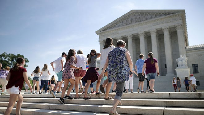 People gather outside the U.S. Supreme Court.