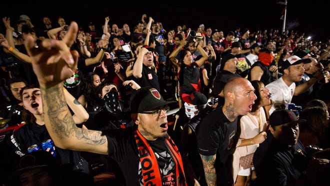 Fans cheer on the Rising on June 29, 2018, during Phoenix Rising FC's 1-0 win against the Orange County Soccer Club at the Phoenix Rising FC Soccer Complex in Tempe, Arizona.