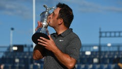 Francesco Molinari kisses the Claret Jug after winning