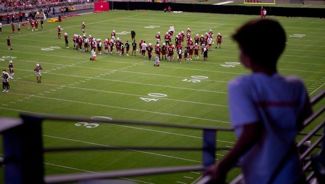 Shiloh Shank, 9, of Phoenix, watches practice on July 28, 2018, during the Arizona Cardinals training camp at the University of Phoenix Stadium in Glendale, Arizona.
