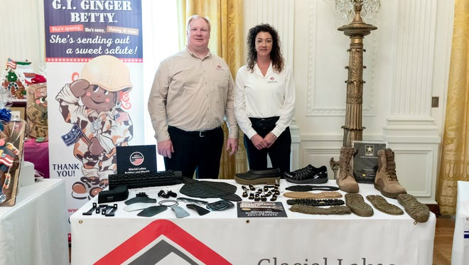 Robb and Jodi Peterson of Glacial Lakes Rubber and Plastics of Watertown show their goods July 23 at the Made in America Product Showcase event at the White House.