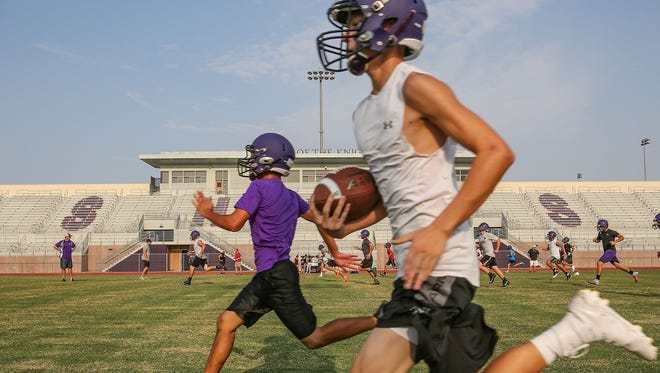 The Shadow Hills football team runs sprints after practice, August 10, 2018.