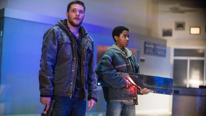 """Jack Reynor as Jimmy, left, and Myles Truitt as Eli, right, in the film """"Kin."""""""