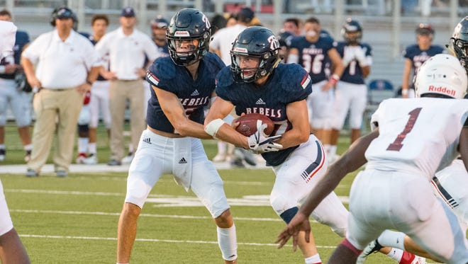 Rebels quarterback Sammy Leblanc hands off to Landon Trosclair as the Teurlings Rebels take on Breaux Bridge. Friday, Aug. 31, 2018.
