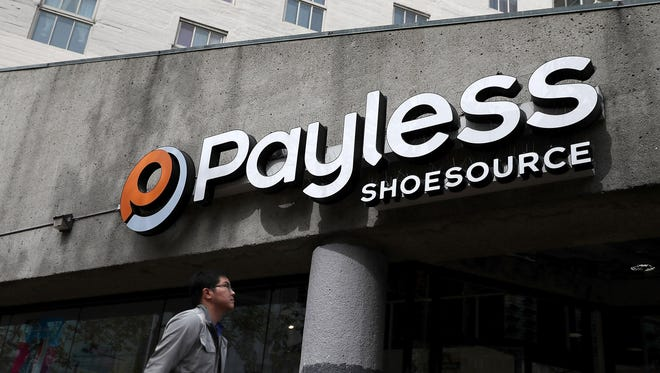 A pedestrian walks by a Payless Shoe Source store on April 5, 2017 in San Francisco, California.