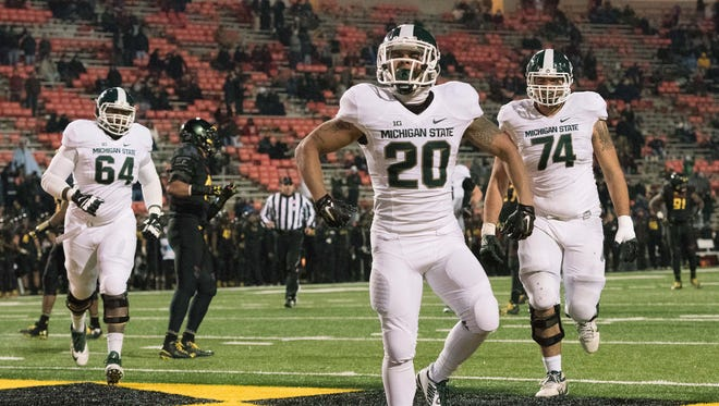 Michigan State Spartans running back Nick Hill (20) celebrates after scoring a touchdown in the fourth quarter against the Maryland Terrapins at Byrd Stadium. Michigan State Spartans defeated Maryland Terrapins 37-15.