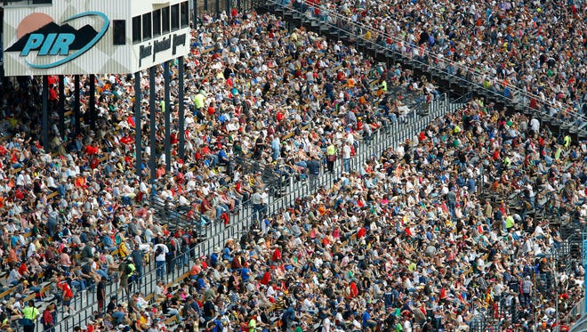 Fans fill the grandstands for the NASCAR Sprint Cup Series Race on Sunday, March 2, 2014 at the Phoenix International raceway in Avondale.