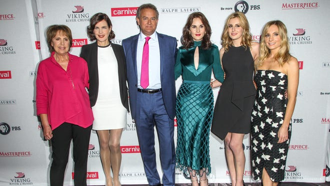 (L-R) Penelope Wilton, Elizabeth McGovern, Hugh Bonneville, Michelle Dockery, Laura Carmichael and Joanne Froggatt attend the 'Downton Abbey' cast photo call during the 2015 Summer TCA Tour at The Beverly Hilton Hotel on Saturday, Aug. 1, 2015, in Beverly Hills, Calif.
