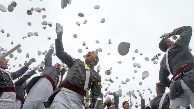 Members of the United States Military Academy graduating class of 2014 toss their caps in the air at the end of commencement exercises in May. West Point saw a dramatic increase in financial gifts in the 2013-14 fiscal year.
