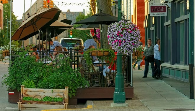 The outdoor dining platforms in Birmingham are popular with the restaurants and their customers. On the flip side, they take up valuable on-street parking spaces.