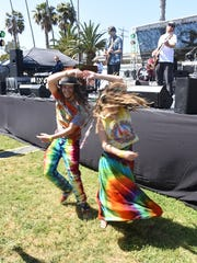 Dancers grooving during Camarillo-based Shaky Feelin's