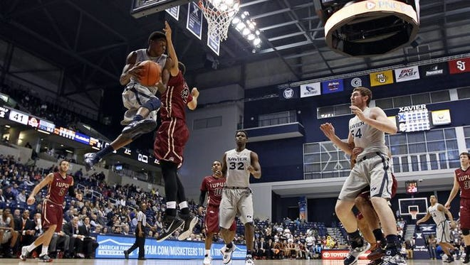 Edmond Sumner goes for two (left) in Xavier's 66-43 win over IUPUI, Tuesday at Cintas Center.