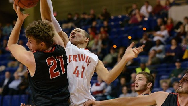 Erwin senior Alic Wynn, shown in a game earlier this season, carried the Warriors to the championship of the Morganton Freedom Christmas Invitational.