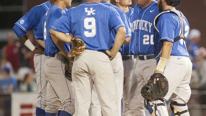 UK baseball coach Gary  Henderson talks to his team during a game last season against U of L.