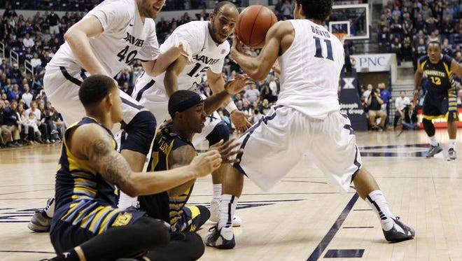 Matt Stainbrook (left), Myles Davis and Dee Davis hope to change Xavier's fortunes in road games, starting at 7 p.m. Thursday at Providence.