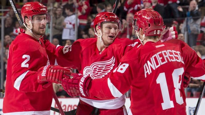 From left, Brendan Smith, Teemu Pulkkinen and Joakim Andersson celebrate after Pulkkinen's goal in the first period.