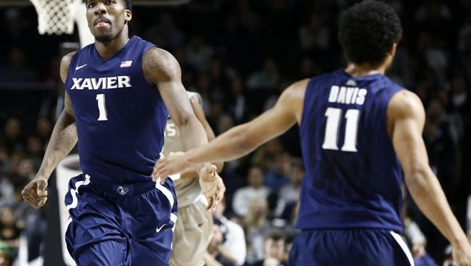 Jalen Reynolds (left) led Xavier in rebounding (13) and added 14 points for his second double-double this season. The Musketeers lost at Providence, 69-66, in overtime Thursday at the Dunkin' Donuts Center.