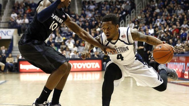 Xavier's Remy Abell (left) and No. 21 Georgetown's D'Vauntes Smith-Rivera will meet again Tuesday in Tuesday's 7 p.m. Big East clash at the Verizon Center. XU won the teams' first meeting, 70-53.
