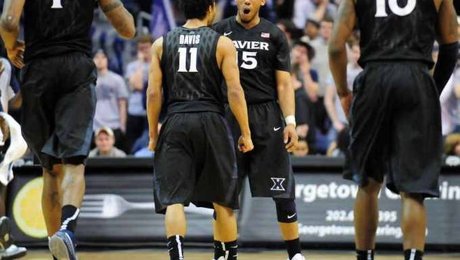 It was at celebratory night for Dee Davis (11), Myles Davis and all Xavier's players and coaches after the Musketeers defeated No. 21 Georgetown in a 66-53 affair at the Verizon Center.