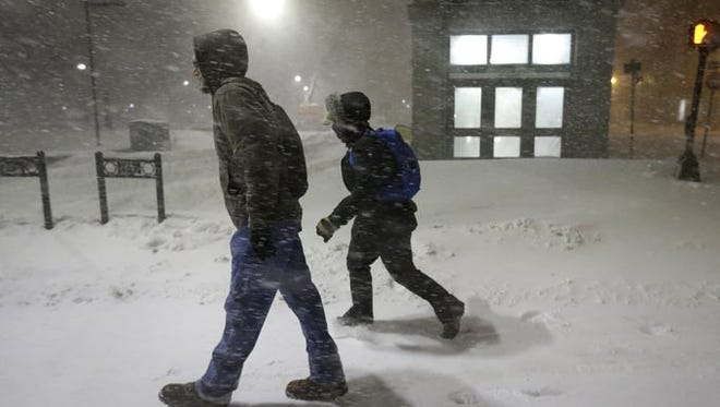 Medical researchers Chris Dubois, left, and Caitlin DuBois walk to work in Boston.