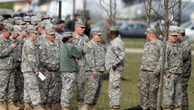 Airmen wait to enter a hangar at Joint Base McGuire-Dix-Lakehurst for President Barack Obama's visit Dec. 15.