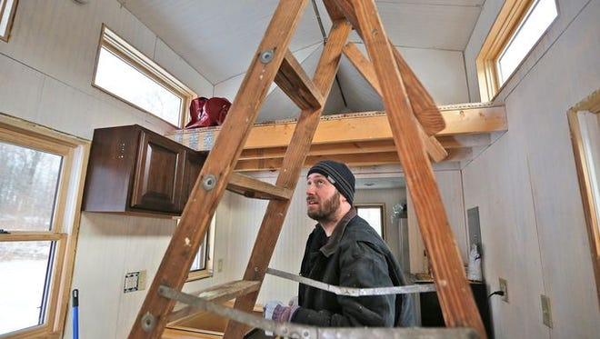 Cori Cox shows his tiny house that he is building in Clay County, Thursday, January 8, 2015.