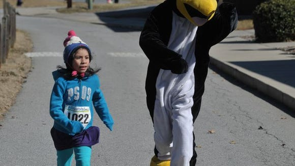 Scenes from the Frostbite 5K and 10K Sunday in Fletcher.