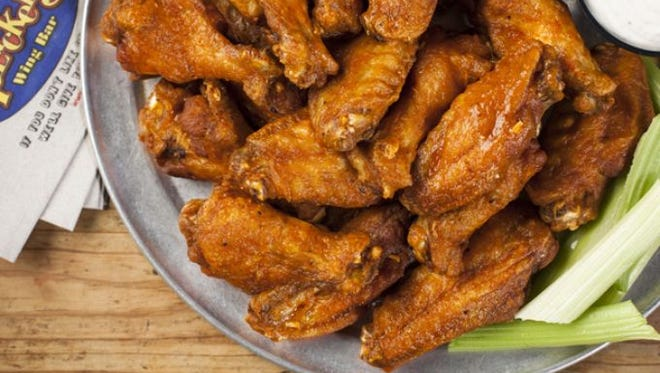 """Multi-state chicken wing chain Pluckers Wing Bar challenges those who dare to consume 25 """"Fire in the Hole"""" wings in one sitting."""