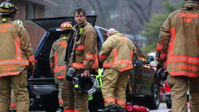 Firefighters at the scene of the fire that claimed Daryl Gordon's life Thursday.
