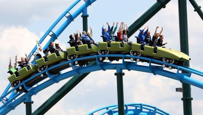 Patrons ride the Lightning Run roller coaster at Kentucky Kingdom in Louisville.