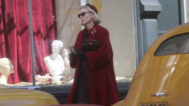 """Oscar-winning actress Cate Blanchett walks down Fourth Street during the filming of the movie """"Carol"""" on the corner of 4th Street and Central Avenue in downtown Cincinnati."""