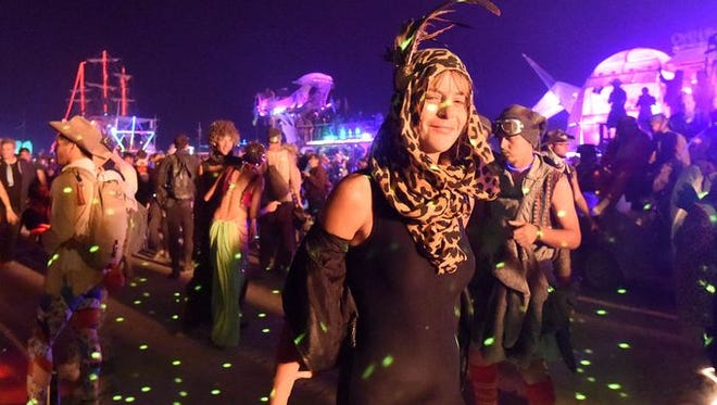 Burning Man participants get ready for the burn on the last night of the festival in 2014 in Nevada's Black Rock Desert.