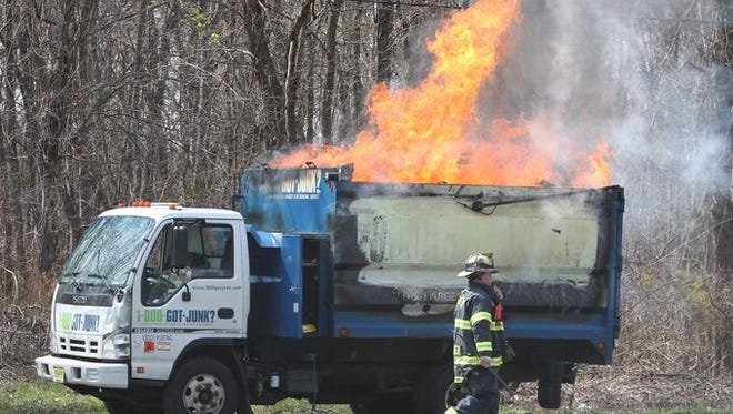 A first-on-the-scene firefighter from the West Nyack Fire Department waits for a fire truck to arrive at a truck fire on Rt. 303 in West Nyack April 21, 2015.