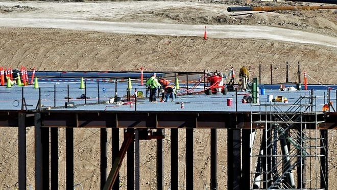 Construction workers at Tesla's gigafactory site just east of Reno.