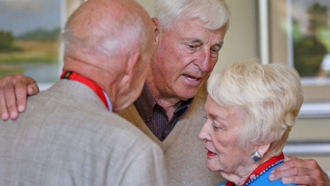 Coach Bob Knight, center, meets and greets guests, including Andy Phillips, left, and Barbara Steinsberger, right, before speaking at The Barrington of Carmel, a retirement community, Wednesday, May 6, 2015.
