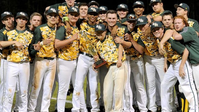 Reynolds baseball players celebrate after winning Thursday's Mountain Athletic Conference 3-A tournament on their home field.