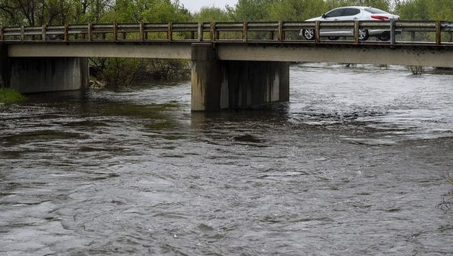 The Poudre River is four times its normal flow rate due to rain.
