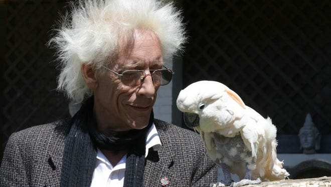 Bill Levin of the Church of Cannabis with his 19-year-old rescue cockatoo Charlie